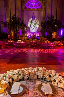 Rosette linens with U-shaped florals and dance floor