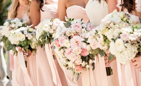 pastel hued bouquets bride bridesmaids pink foliage ribbons california wedding