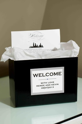 Black bag with Chicago-theme wedding itinerary card