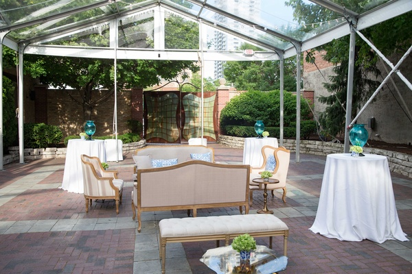 outdoor tented setting, beige seating, southern-inspired wedding