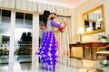 south asian couple dances in hotel room at sangeet