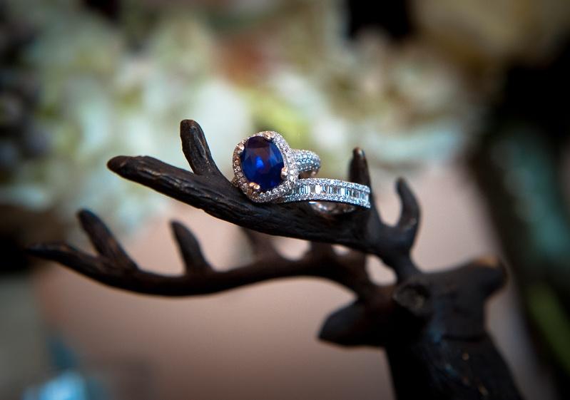 Blue jewel stone with halo diamonds and eternity band