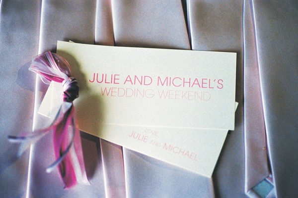 White stationery tag with pink and purple ribbon