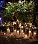wedding reception greenery purple blue delphinium candles ghost chairs purple lighting