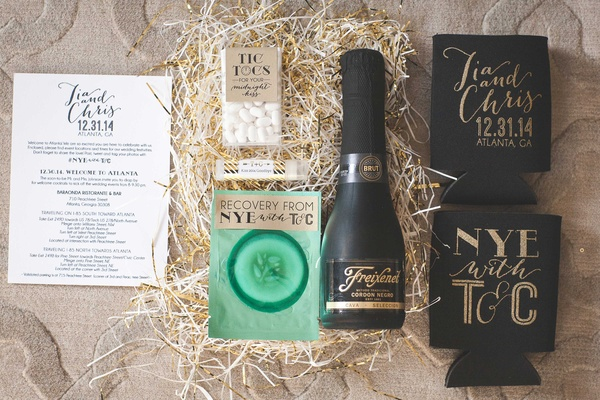 New Year's Eve wedding gift box favor with Friexenet, cucumber pad, koozies, tic tacs, lip balm