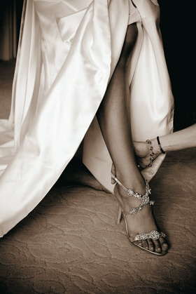 Sepia tone picture of strappy Manolo Blahnik wedding shoes