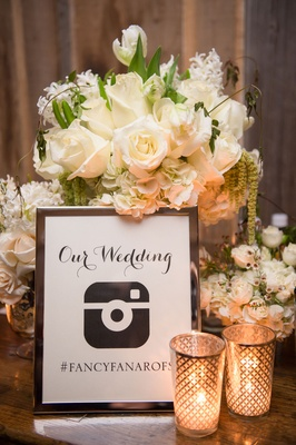 framed sign displaying wedding hashtag for Instagram