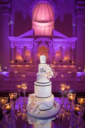 Tall black white and gold wedding cake at Vibiana with monogram