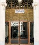 Vintage hotel entryway with neon sign