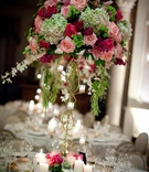 Indoor wedding reception flower arrangement with gold stand