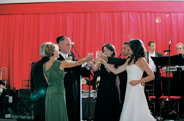 Bride and groom toast parents at wedding reception