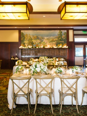 the lodge at torrey pines wedding reception wood vineyard chairs white linen greenery white flowers