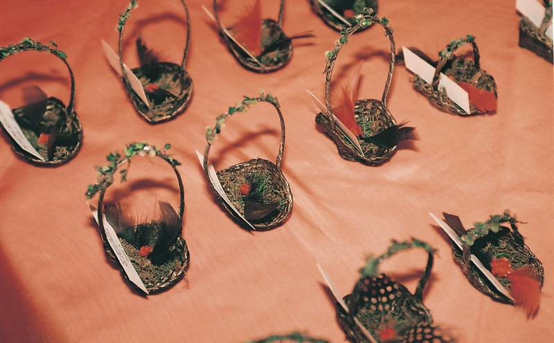 place card holders made from tiny baskets and feathers