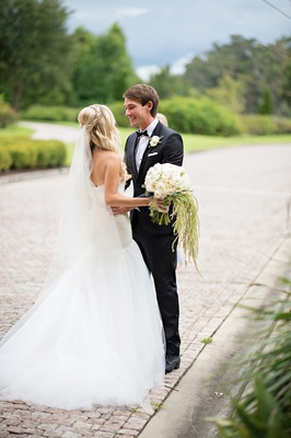 Groom in tux sees bride for first time at Italian venue