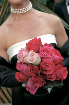 Bridesmaid holding pink and red rose bouquet