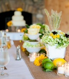 White reception table with burlap runner and wood table number