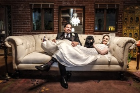hector maldonado bassist from train in tommy hilfiger, bride in oscar de la renta on couch dachshund