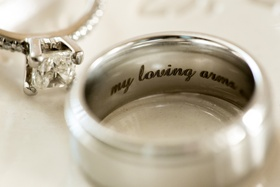 Bride's princess-cut diamond engament ring, grooms classing wedding band with inscription, my loving