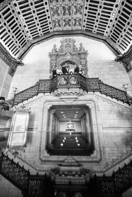 Black and white photo of wedding party the architecture of the Millennium Biltmore Hotel Los Angeles