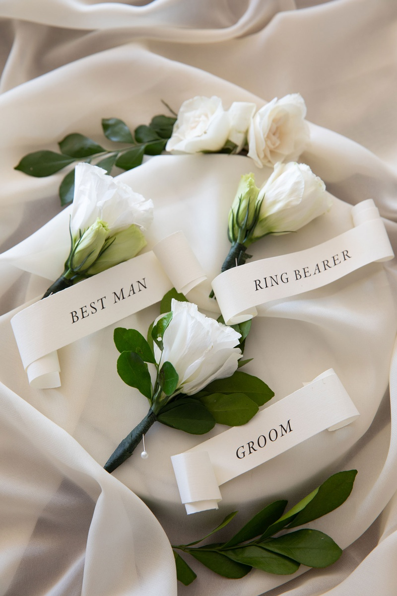 wedding boutonniere flower white bloom greenery banner ribbon with groom best man ring bearer pins