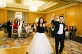 Bride in a strapless Vera Wang gown with a black bodice and white skirt with groom in black tuxedo