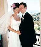 Bride in sheath wedding dress with groom