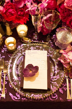 purple and pink tablescape table linens glass plateware floral arrangements candles menu calligraphy