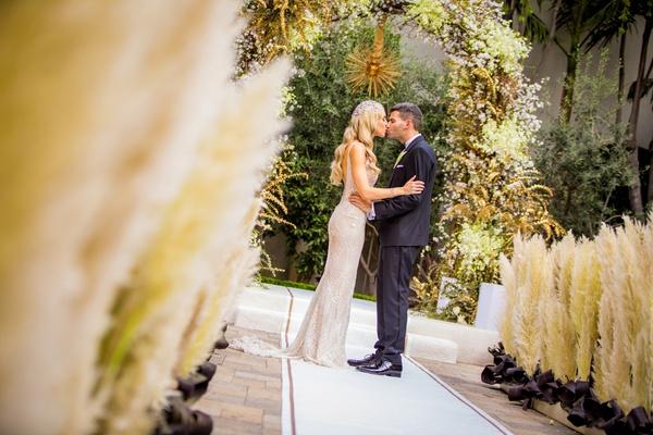 pampas grass along aisle, art deco inspired wedding, elaborate chuppah