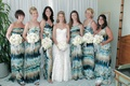 bridesmaids wearing tie dye style blue white and brown dresses