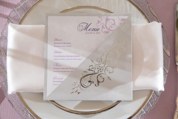 Wedding menu card purple linen silver charger plate white napkin purple menu