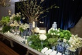 escort card table mirror top with blue and white chinoiserie ginger jar vases floating candles white