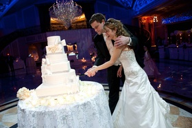 Bride and groom cut the wedding cake