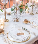 wedding reception gold rim charger plate kraft paper place card red white string bread plate