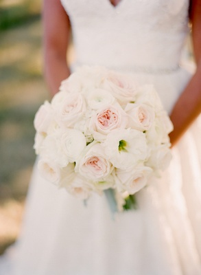 Brides bouquet of white and pink garden roses with white lisianthus
