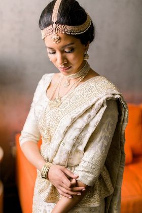 sri lankan south asian bride in ivory and gold sari with headpiece