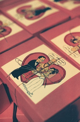 Red wedding favor boxes with cartoon and twine
