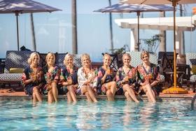 bride bridesmaids robes feet in pool drinks mimosas wedding california la valencia hotel fun