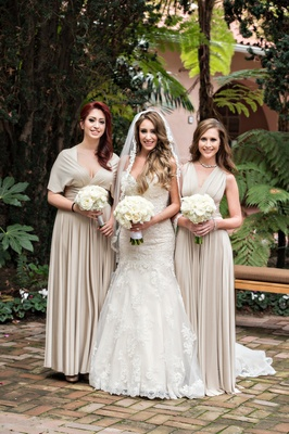 bride in kittychen couture lace gown, bridesmaids in tan bhldn dresses