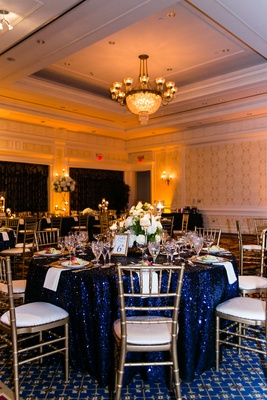 Ballroom wedding with sequined tablecloth and gold chairs