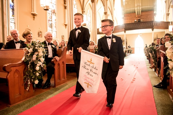 ring bearers in tuxedos, ring bearer in glasses with banner