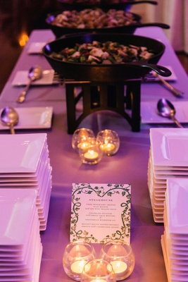 Wedding food station buffet steakhouse station with purple lighting and candles