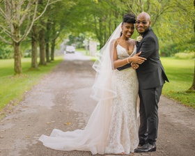 bride in eddy k lace dress, blush overskirt, horsehair veil, groom in suit