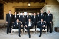 Groom with best man on chair and standing groomsmen