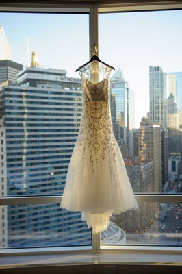monique lhullier fit and flare gown with beaded tulle overlay and keyhole back hanging in Chicago