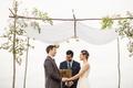 Wedding ceremony under chuppah hand made by groom best friend officiant vineyard wedding