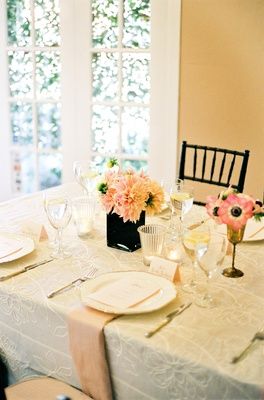 Tablescape with ivory linens and peach accents