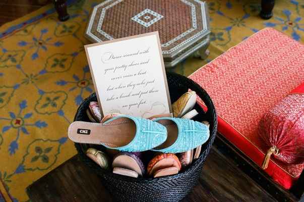 Wicker basket filled with comfortable half slippers