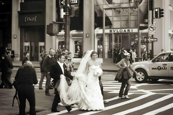 Black and white photo of bride and groom walk through NYC by Bvlgari