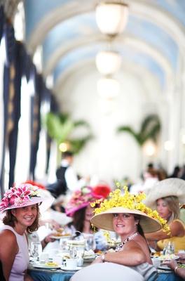 Female wedding guests wearing Kentucky Derby hats
