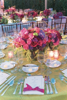 Green tablecloth with rose flower arrangement
